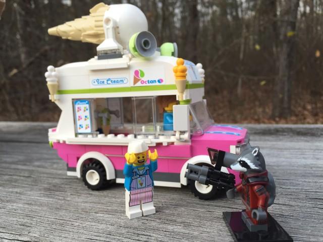 LEGO Rocket Raccoon Minifigure Holds Up an Ice Cream Truck