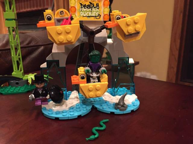 LEGO Beast Boy Minifigure Rides Deadly Duckies with Penguin Minifigure